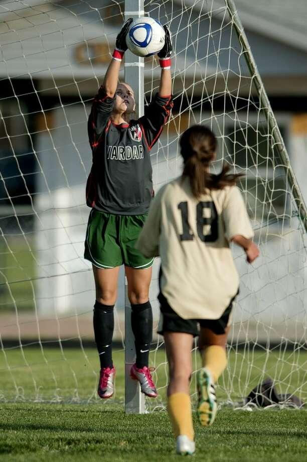 NICK KING | nking@mdn.netFreeland goalkeeper Sarah Yancer blocks a shot as Bullock Creek's Mirejah Cruz, right, looks on during the first half Monday at Bullock Creek High School. Freeland won 4-0. Photo: Nick King/Midland  Daily News