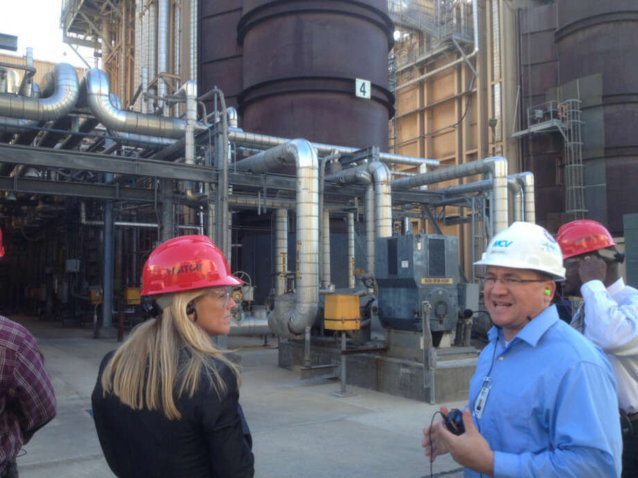Tony Lascari | tlascari@mdn.netPhyllis Cuttino, director of Pew Environment Group's Clean Energy Program, listens to Brian Vokal, Midland Cogeneration Venture vice president of operations, maintenance and engineering, who led a tour of MCV's Midland site Monday.