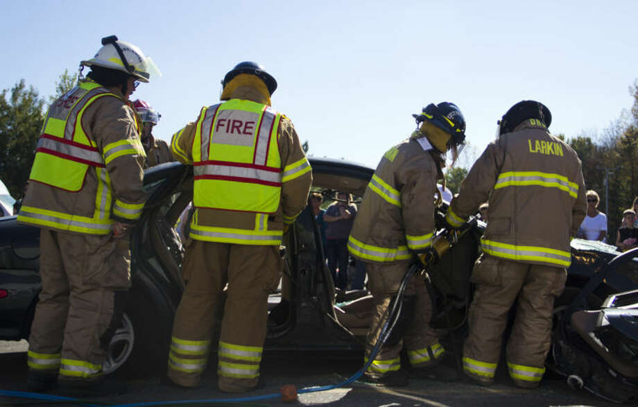 EMILY BROUWER | for the Daily NewsLarkin Township firefighters demonstrate the Jaws of Life at the fire department open house at the Larkin Township Fire Hall. At the open house, youths and adults were able to try on gear and climb into the fire trucks.