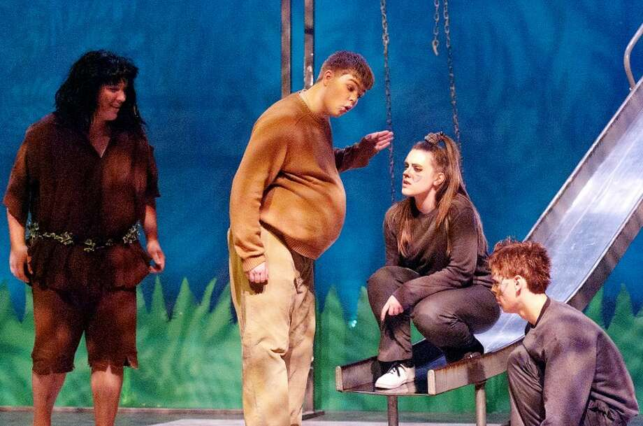 "From left, Luke Hotchkiss as Mowgli the mancub, Scott Bays as Baloo the bear, Larissa Husted as Grey the wolf and Joel Marty as Grab the wolf in the H.H. Dow High School Drama Club's production of ""Jungalbook."" Photo: STEVEN SIMPKINS 