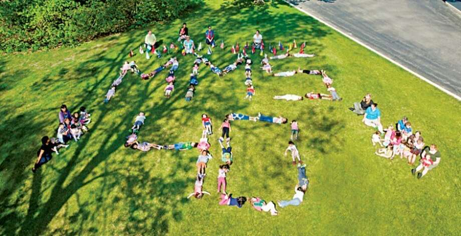 Photo providedChildren lie on the ground spelling out MMS 40 in recognition of the Midland Montessori School's 40th anniversary this year. Photo: Edit1