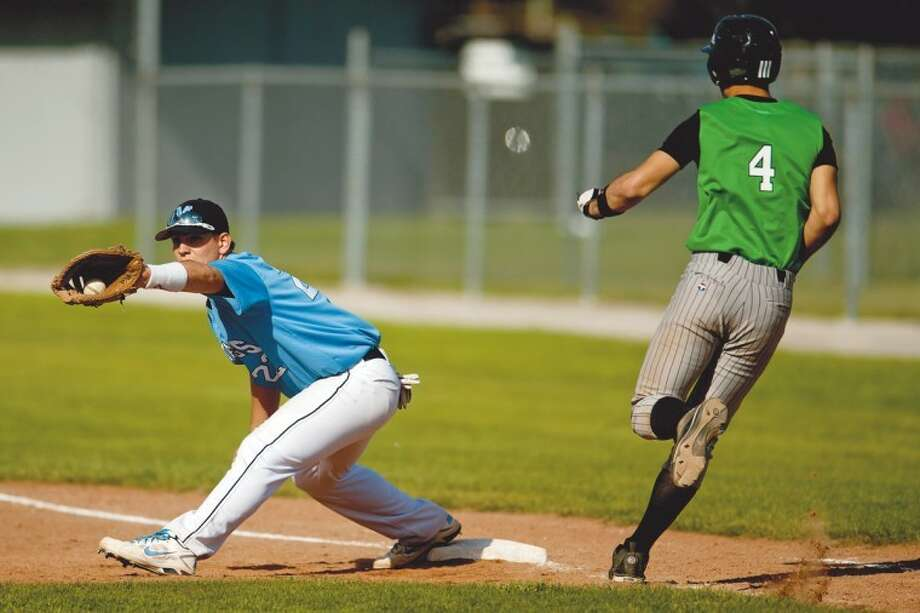 THOMAS SIMONETTI | tsimonetti@mdn.netMeridian first baseman Peyton Marshall stretches to make the final out in the first game of a doubleheader against Houghton Lake Thursday at Meridian. Photo: Thomas Simonetti