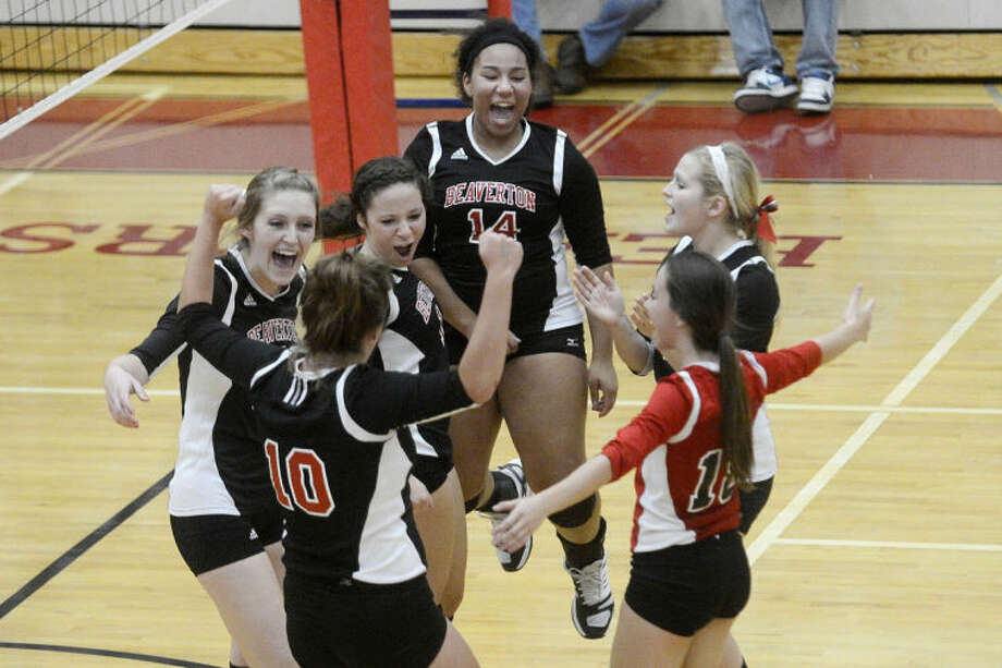 NICK KING | nking@mdn.netFrom left, Beaverton's Katie Hedrick, Emilee Grove (10), Mercedes Parker-Urban, Ashton Snyder, Jasmyn Parker-Urban and Tiffani Stewart celebrate a point during their game Monday at Beaverton High School. Photo: Nick King