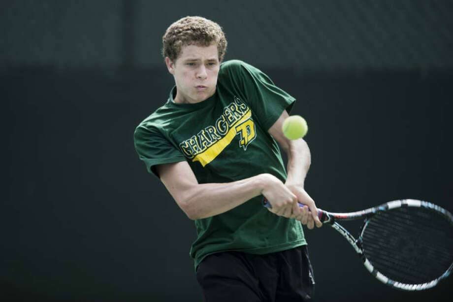 NEIL BLAKE | nblake@mdn.netDow High's William Kirkman, a sophomore, has had a very good year at No. 1 singles. Kirkman and his teammates are playing in the Division 2 state finals this weekend in Holland. Photo: Neil Blake/Midland  Daily News