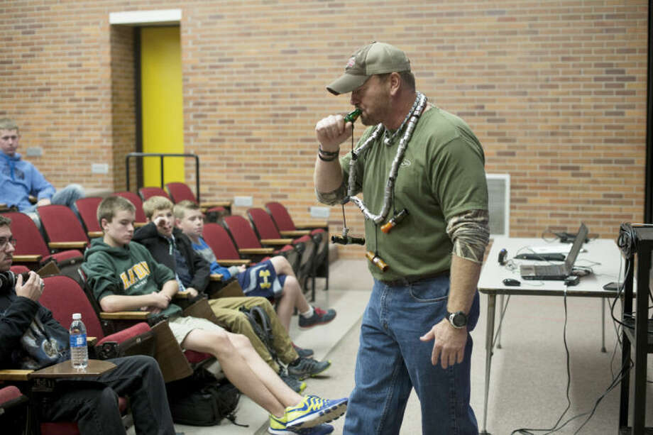 NEIL BLAKE | nblake@mdn.netGeorge Lynch, designer of Lynch Mob Calls, demonstrates a call during a recent talk at Dow High School. Photo: Neil Blake/Midland  Daily News