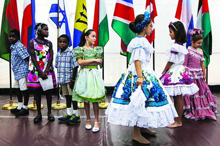 CHUCK MILLER | for the Daily News Kids stand in line before going up on stage during the Parade of Nations at the Hach Student Life Center at Northwood University as part of Cultural Awareness month in Midland. Kids wore attire representing each of their respective nations. Photo: CHUCK MILLER