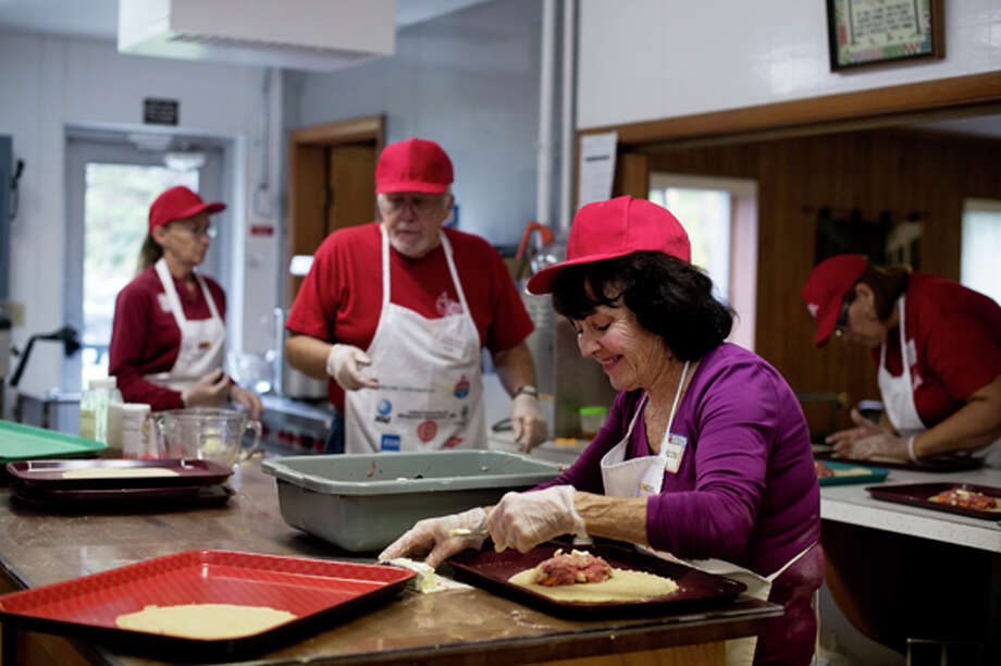 Maureen Nestor of Shields prepares a pasty in Laporte United Methodist Church on Wednesday. Photo: Neil Blake/Midland  Daily News / Midland Daily News