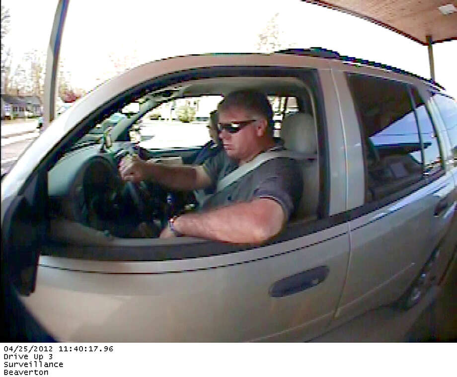 Photo providedTroopers have released this photo taken by bank security cameras on April 25 showing the suspect behind the wheel of a gray vehicle.