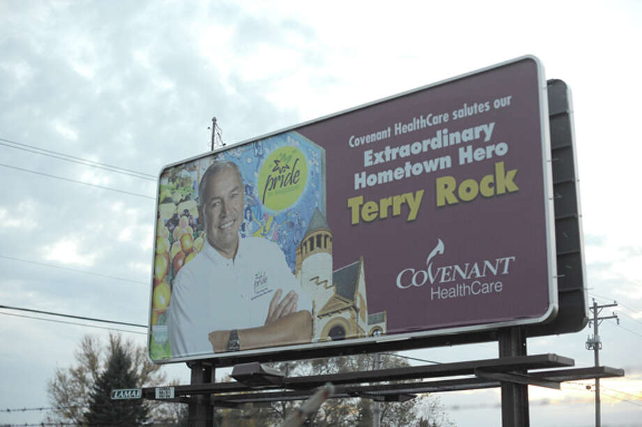 One of six billboards posted around the Saginaw Bay area showing Terry Rock, who was recently named Hometown Hero in a Covenant HealthCare contest on Facebook. In addition to the billboards, Rock received a dinner at his favorite restaurant and a $500 gift to donate to the non-profit of his choice. Rock chose PRIDE, an organization that works to develop and promote downtown Saginaw. Photo: NEIL BLAKE | Nblake@mdn.net / Midland Daily News | Neil Blake