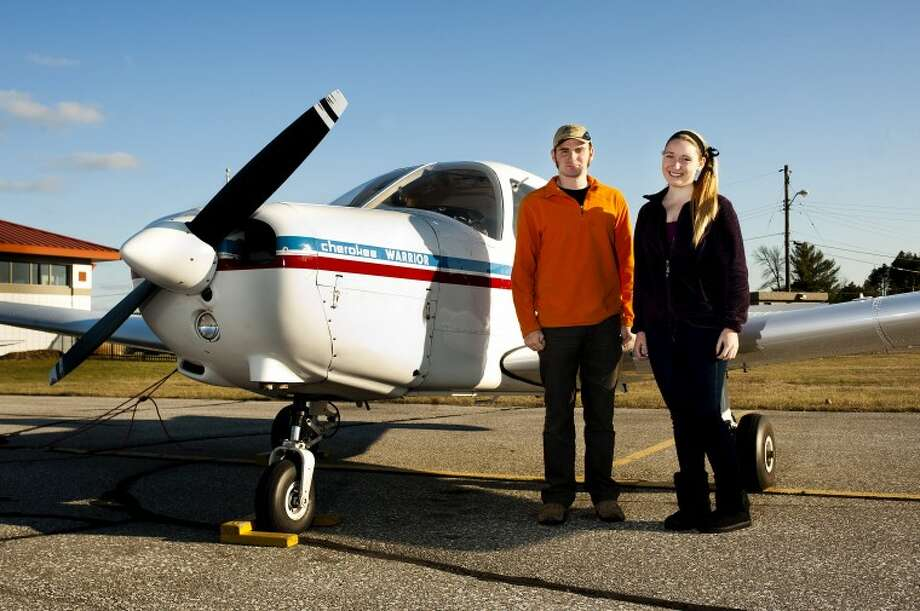 David and Tina Druskins, 17, pictured at Jack Barstow Municipal Airport are twins and are both pursuing their pilots' licenses. Recently, they have both chalked up their first solo flights. Photo: NEIL BLAKE | Nblake@mdn.net