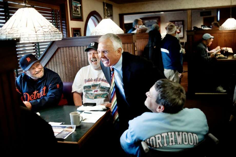 NICK KING | nking@mdn.netNew York Mets' manager Terry Collins, center, who grew up in Midland, jokes with guests, from left, John Behnlander, Glenn Isenhart and Roger Isenhart before speaking during the monthly Midland sports luncheon Wednesday at Damon's Grill. Also seated at the table are Oren Mieske and Larry Jaster. Collins just finished his first season with the Mets. Photo: Nick King/Midland  Daily News