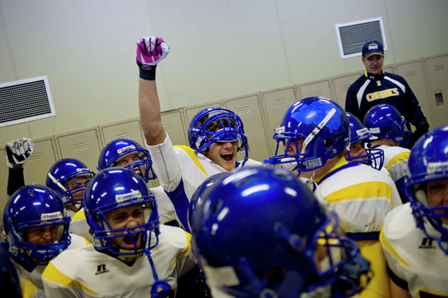 NICK KING | nking@mdn.net Midland High's Austen Irrer, center, and the rest of the Chemics cheer in the locker room before the start of their game against the Chargers Friday at Midland Community Stadium. The Chemics beat Dow 45-6. Photo: Nick King/Midland  Daily News / Midland Daily News