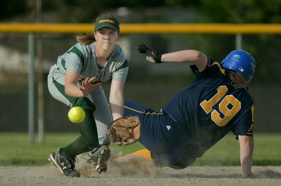 NICK KING | nking@mdn.netDow's Kaity Bourque, left, prepares to catch a throw as Midland's Paige Barber slides in safely at second base Thursday at Midland High School. Photo: Nick King/Midland  Daily News