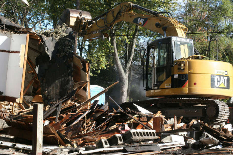 HILARY FARREL | for the Daily NewsA house is torn down this week in Saginaw, one of 950 abandoned structures to be demolished as part of the Troubled Asset Relief Program.
