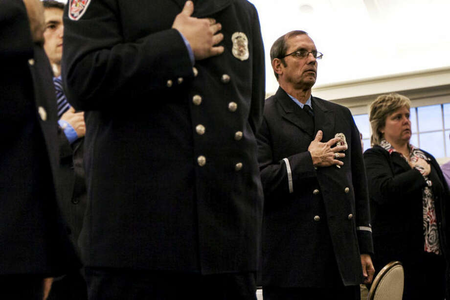 CHUCK MILLER | for the Daily NewsLt. John Day of the Midland Fire Department stands during the pledge of allegiance Tuesday evening during the Carl and Esther Gerstacker 2013 Law Enforcement and Firefighter of the Year Awards Banquet at the Midland Country Club. Photo: CHUCK MILLER