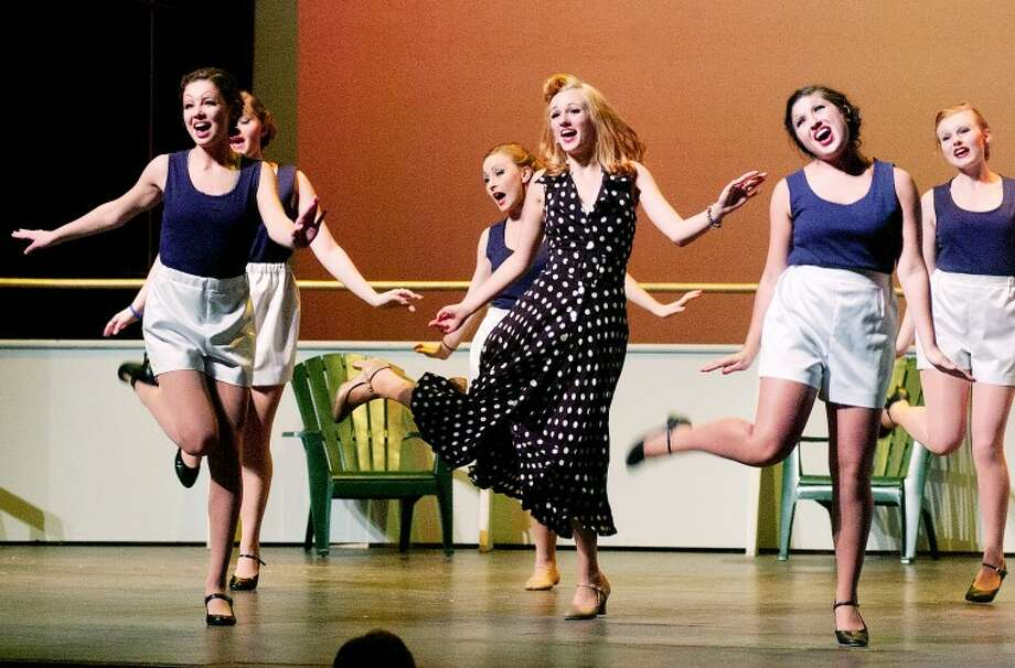 "STEVEN SIMPKINS | for the Daily NewsErica Bigelow, center,  as Bonnie, dances and sings with fellow performers during a recent rehearsal of the Midland High School production of ""Anything Goes."" The production opens tonight."