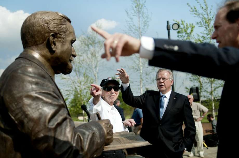 NICK KING | nking@mdn.net From left, Dow Foundation president Margaret Ann Riecker, Dow Chemical Co. executive vice president, business services, chief sustainability officer and chief information officer David Kepler and Congressman Dave Camp talk about Founder's Garden during a dedication ceremony Thursday at the garden next to Dow Diamond. At left is a statue of Herbert Henry Dow who the garden was built for in honor of his legacy. Chemist Herbert Henry Dow founded Dow Chemical in 1897. Photo: Nick King/Midland  Daily News