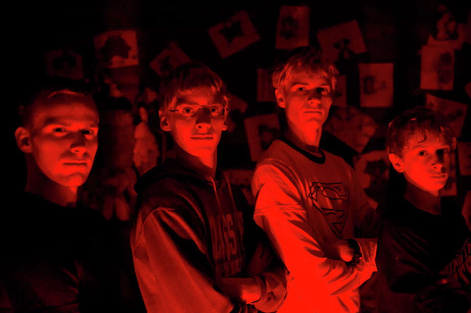 NICK KING | nking@mdn.net The Sira brothers, from left, Jake, 19, James, 17, John, 16, and Joseph, 13, have created the Sira Haunted Pole Barn at their home in Midland County. The brothers hope to raise money to buy more props for next year. Photo: Nick King/Midland  Daily News / Midland Daily News