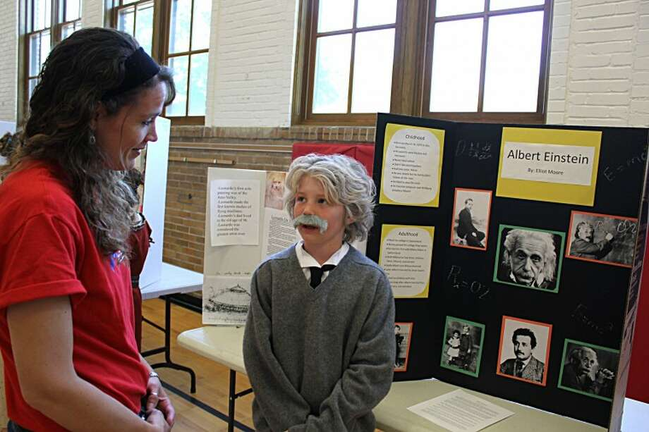 Tracy Burton | for the Daily NewsFifth-grader Elliot Moore explains who Albert Einstein is to his teacher, Jennifer Suarez.