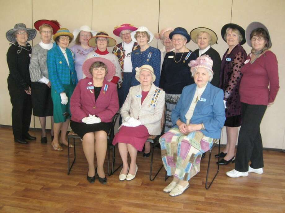 Photo providedMembers of the John Alden Chapter of DAR celebrated the 90th birthday of the chapter, honoring the founding members by wearing hats and gloves. Shirley Russell, Regent of the current chapter, is seated in the center of the picture.