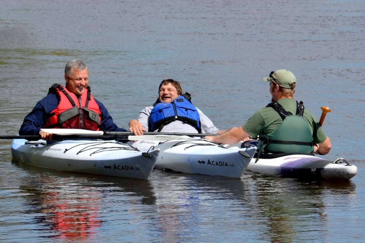 Steve Griffin   for the Daily NewsRoger Isenhart, flanked by the Chippewa Nature Center's Tom Lenon (left) and Curt Holsinger, enjoys a float on the Tittabawassee.