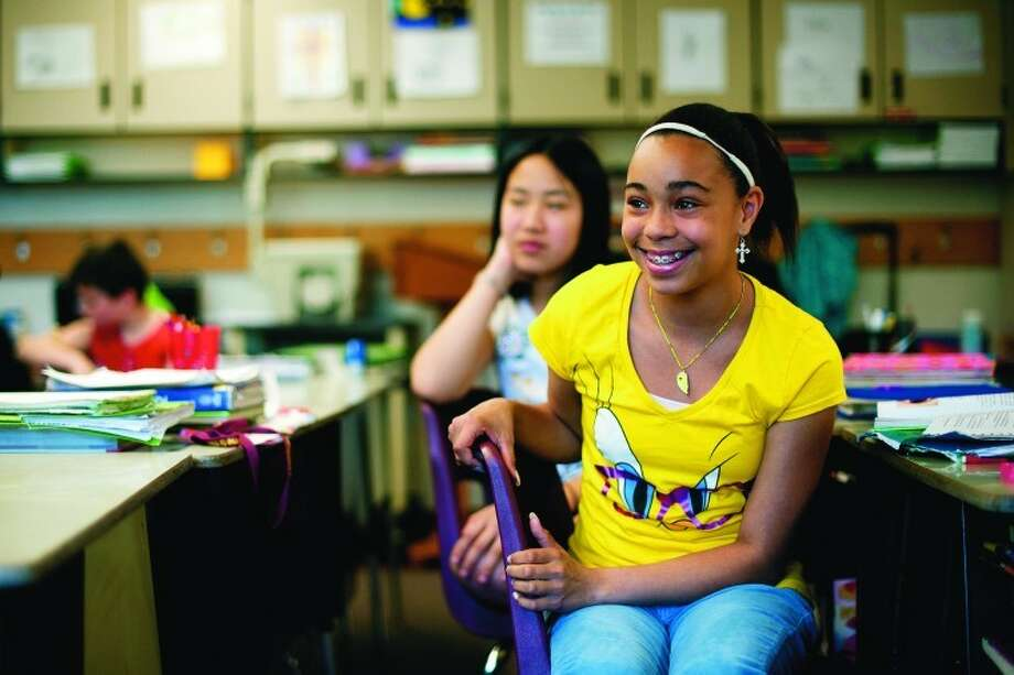 Stella Stark, a sixth grader in Beth. Bluemer's class at St. John's Lutheran School in Midland, smiles as she tells what she hopes to do over summer vacation. Photo: Thomas Simonetti