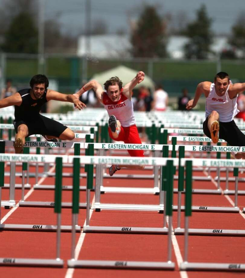 Photo providedMidland's Vince Lefler, middle, competes in a meet at Eastern Michigan. Lefler is a hurdler at the University of Detroit.