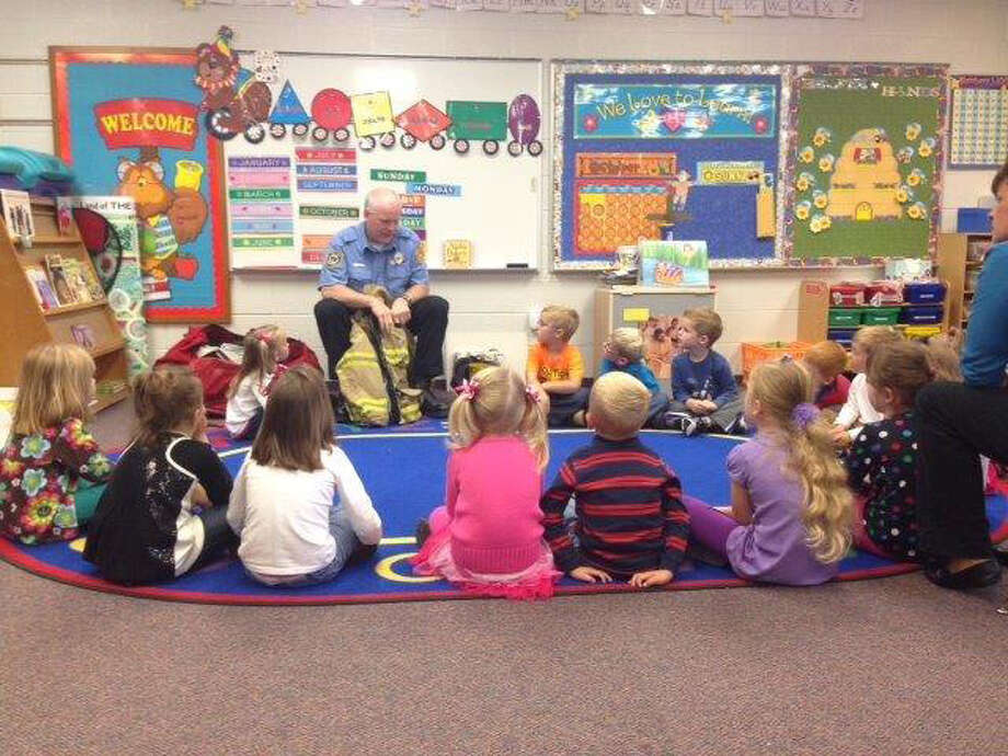 Photo providedA Midland area firefighter visits with students in St. JohnÕs Lutheran preschool.