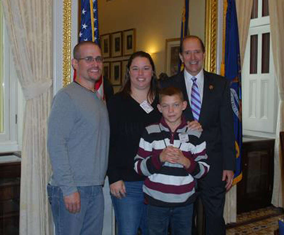 Kurt, Andrea and Austin Johns are shown with U.S. Rep. Dave Camp in Washington, D.C.
