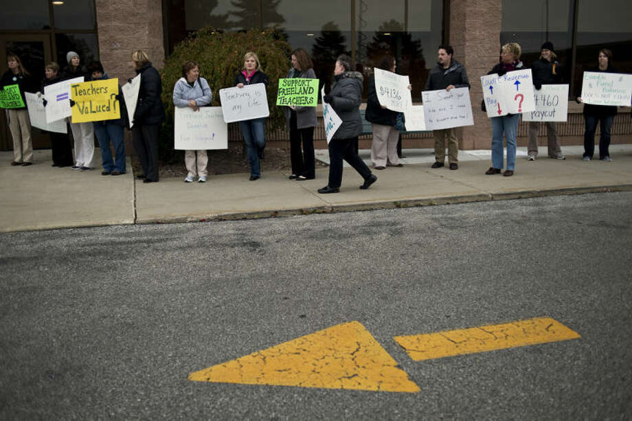 SEAN PROCTOR   sproctor@mdn.netFreeland teachers picket outside of Freeland High School before a board of education meeting Monday evening. The teachers are unhappy about recent contract negotiations, including proposed wage cuts. Photo: Sean Proctor/Midland  Daily News