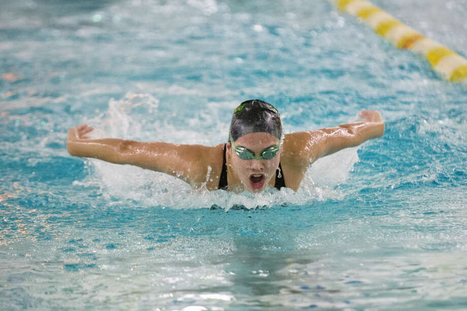 NICK KING | nking@mdn.netDow's Julia Ahrns competes in the 100 yard butterfly race Tuesday at Dow High School. Photo: Nick King/Midland  Daily News
