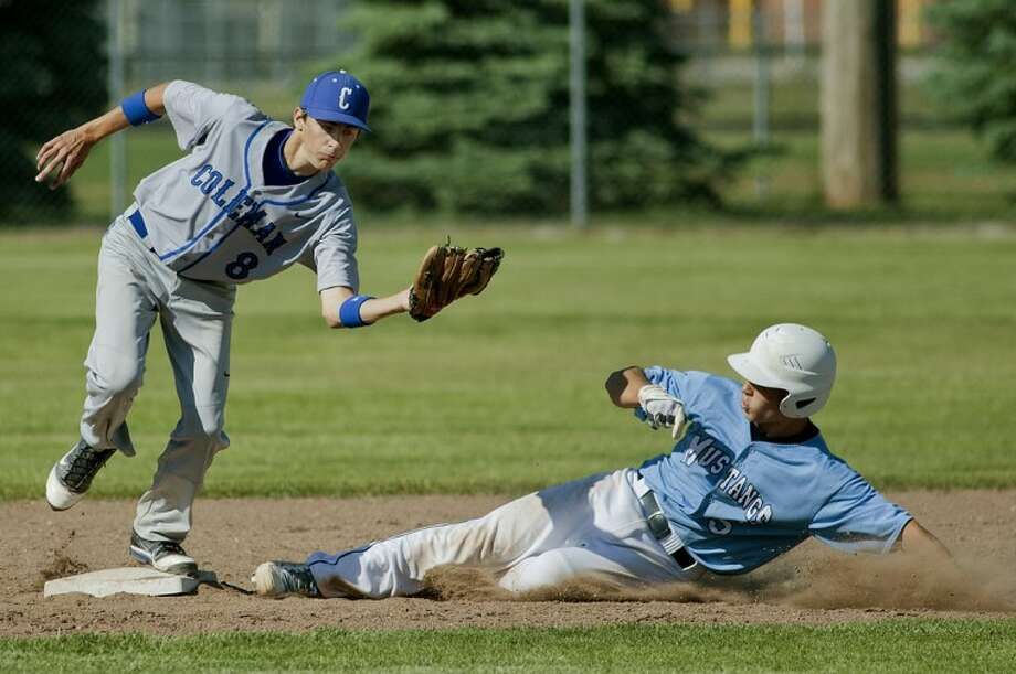 NICK KING | nking@mdn.net Coleman's Brad Crowl, left, tags out Meridian's Zach Arthur at second base in the sixth inning Friday at Meridian High School. Coleman beat Meridian 1-0 in the first game of a doubleheader. Photo: Nick King/Midland  Daily News