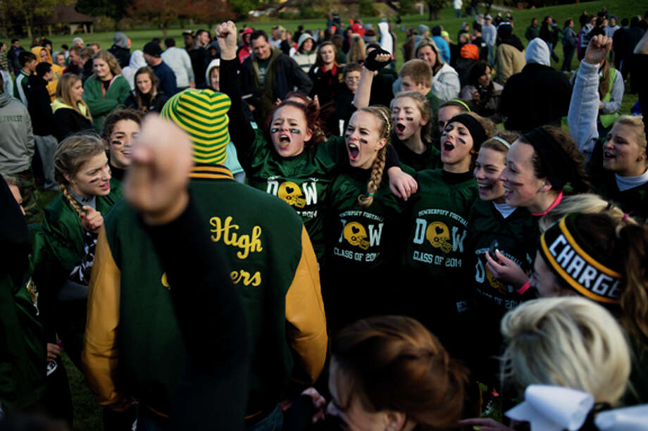 H.H. Dow High School seniors cheer after defeating their rival Midland High School in their annual Powder Puff game. The Chargers won 20-14. Though the game is not sanctioned by Midland Public Schools, it was well attended and is a tradition for many of the students. Photo: Neil Blake/Midland  Daily News / Midland Daily News