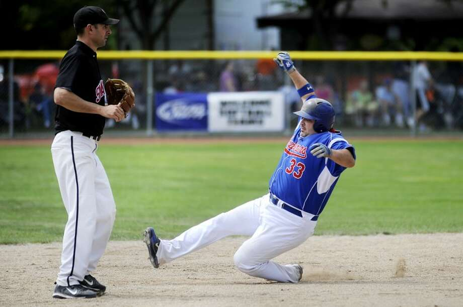 NICK KING | nking@mdn.netExplorers' Steve Roberts slides safely into second base as the Snappers' Peter Dobbin looks on during the second inning Wednesday at Currie Stadium.