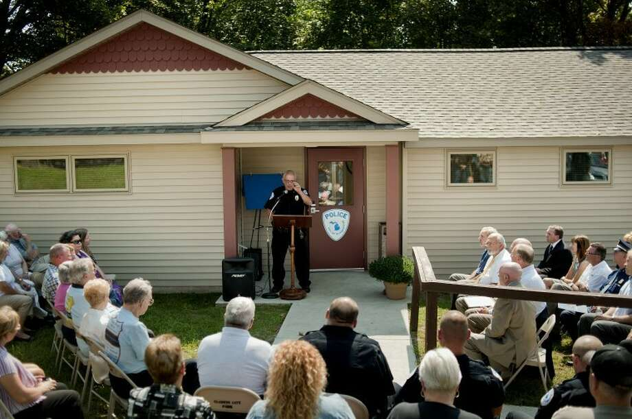 NICK KING | nking@mdn.net Gladwin Police Chief Charlie Jones, center, speaks to a crowd during a grand opening ceremony Thursday at the Gladwin Police Department building. Renovations to the building include new locker rooms, interview and training areas to name a few. Photo: Nick King/Midland  Daily News