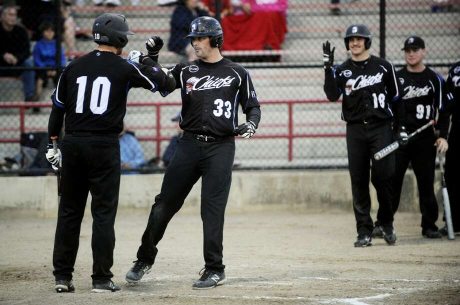 NICK KING | nking@mdn.net Hill United's Steve Mulleway, right, celebrates his solo home run with teammate Jason Hill, left, during the second inning Friday at Currie stadium.