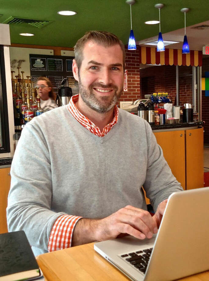 "Joe Mortensen | for the Daily NewsLead Pastor/Church Planter Shawn May of newly-established Trinity Grace Church of Midland is shown at Cup and Chaucer Coffee Bar at Grace A. Dow Memorial Library where May keeps ""office hours"" one afternoon a week."