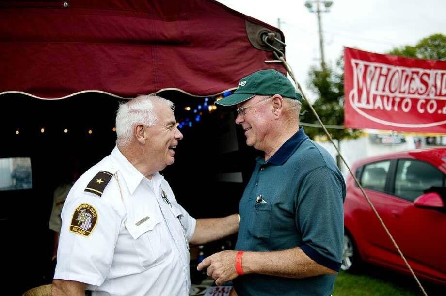 NICK KING | nking@mdn.netMidland County Fair Manager Tom Valliere, right, talks with Midland County Sheriff Jerry Nielsen Thursday at the Midland County Fair. Both men are retiring from their positions this year. Photo: Nick King/Midland  Daily News
