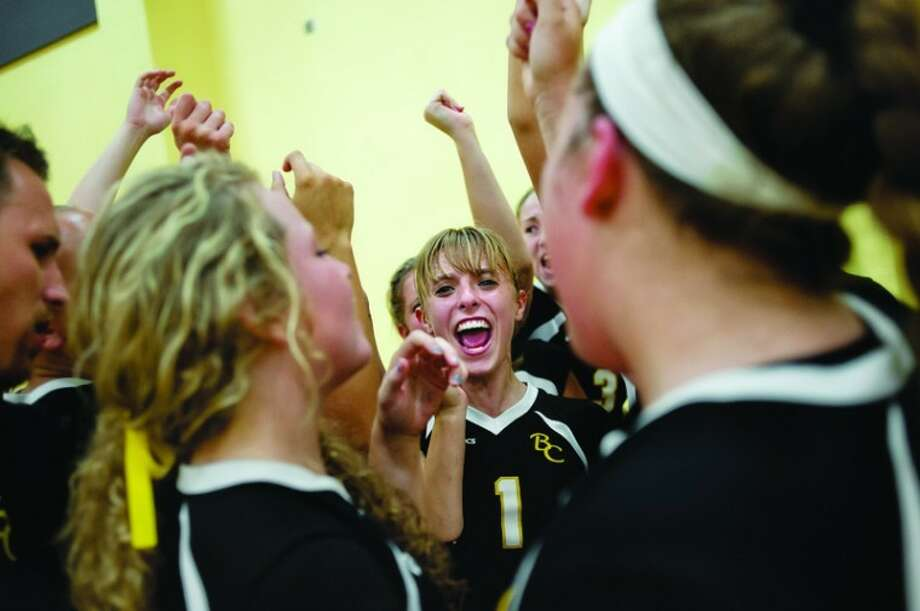 NICK KING | nking@mdn.net Bullock Creek's Amy Siegel, center, celebrates with teammates after the Lancers beat Meridian in a volleyball match Wednesday at Bullock Creek High School. The Lancers beat the Mustangs in two straight sets. Photo: Nick King/Midland  Daily News