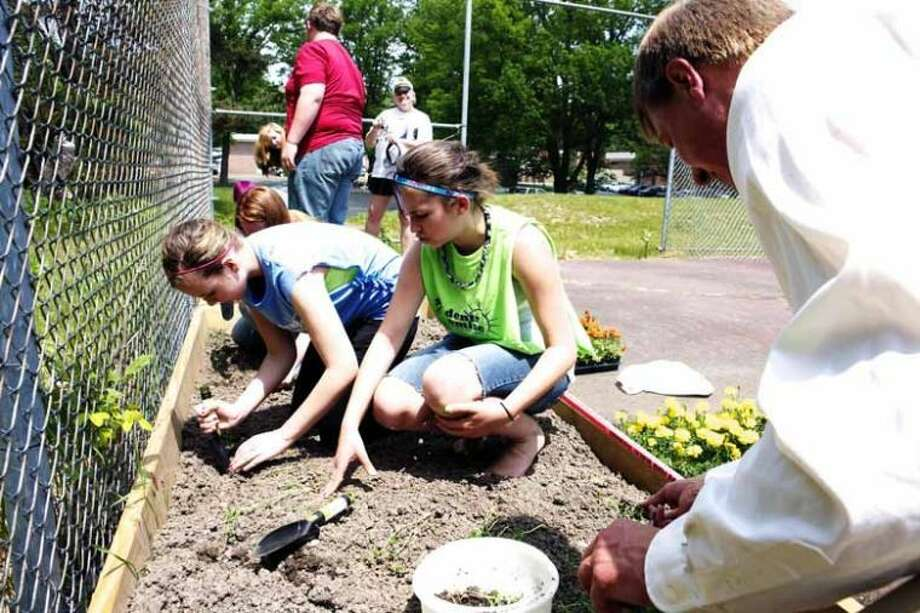 Photo providedParticipants from Mid Michigan Community College's Students of Promise program plant a garden at the Harrison campus.