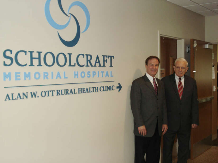 Photo providedAlan Ott, right, is shown with Bill Schuette in front of the new sign.