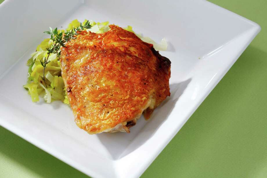 Add crusty bread and a salad to make these pan-roasted chicken thighs with buttered leeks into a big, hearty meal. Photo: Craig Lee /Special To The Chronicle / ONLINE_YES