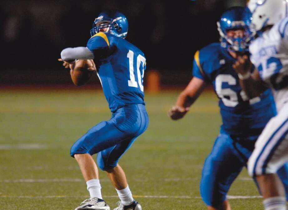 Andrew Maxwell winds up to throw a deep pass during his junior year at Midland High.