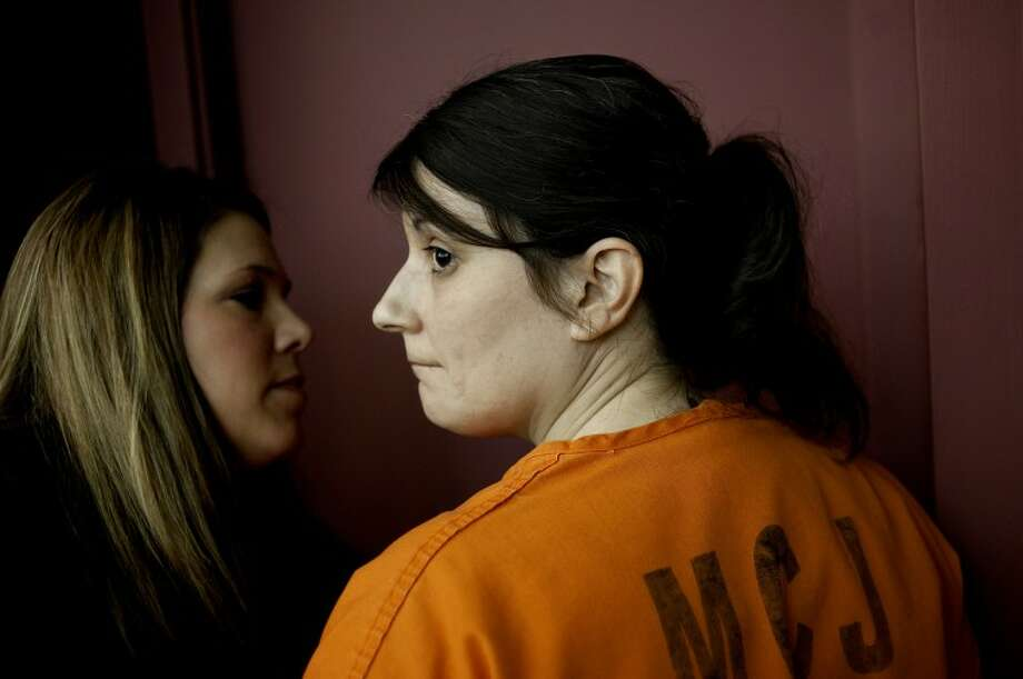 NICK KING | nking@mdn.net Rachel Moore pauses and looks back while being escorted out of the courtroom after being sentenced to life in prison for the first-degree murder of Brian Lynn Reichow Thursday Midland County Courthouse. Midland County Circuit Court Judge Jonathan E. Lauderbach handed down the sentence. Photo: Nick King/Midland  Daily News