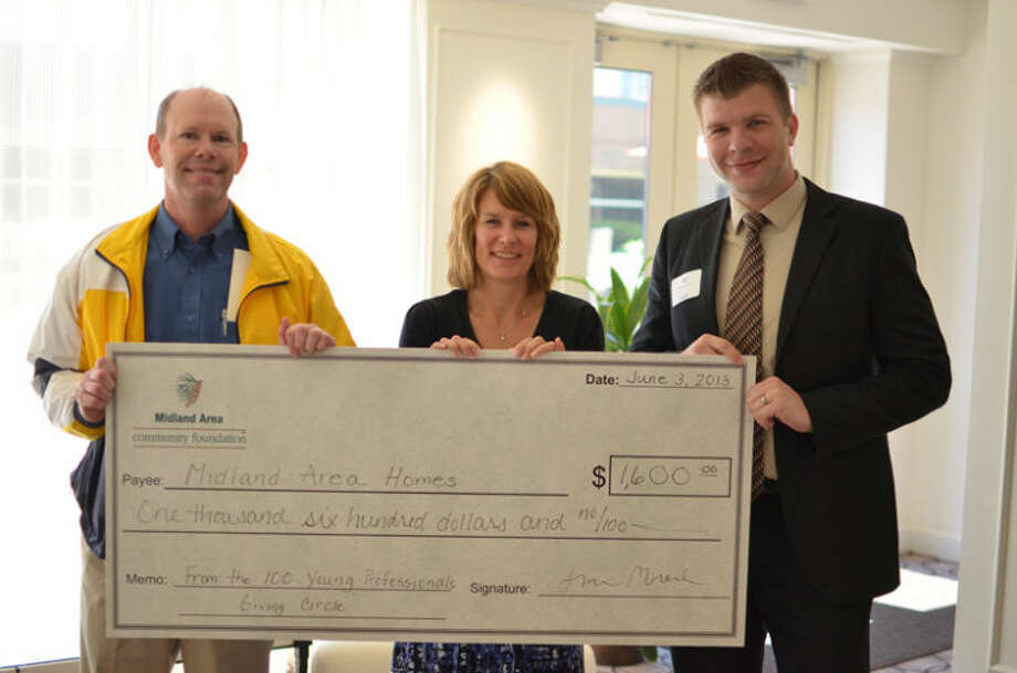 Photo providedPictured, from left, are Richard Peterson, Midland Area Homes; Nancy Money, Midland Area Community Foundation; and John Haag, 100 YP Club committee chair.