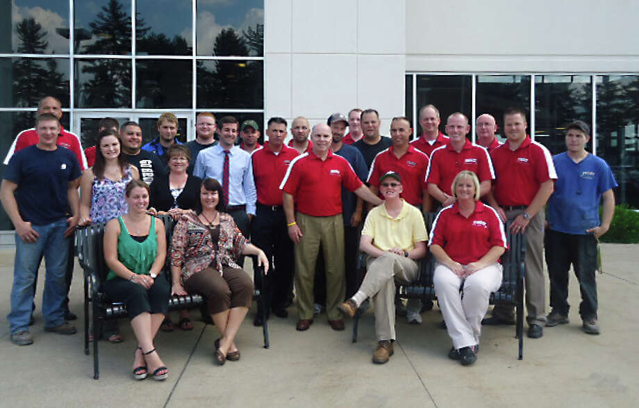 Photo providedFeeny Chrysler Dodge Jeep Ram President Bob Feeny, center, is shown with employees of the dealership.
