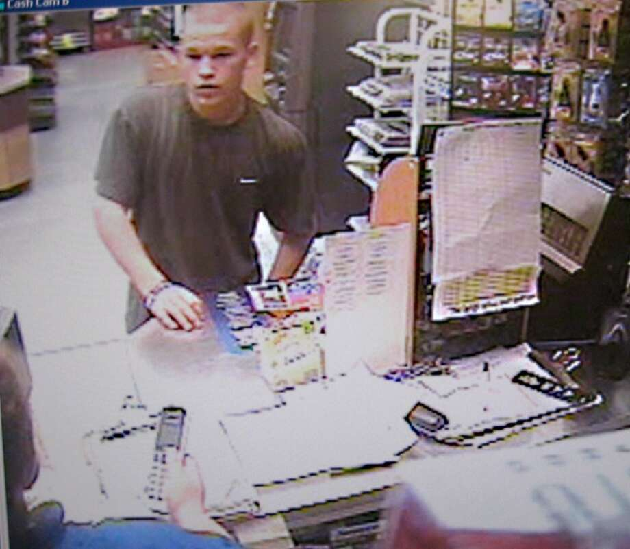This photograph shows one of the suspects at the Admiral gas station in Midland.