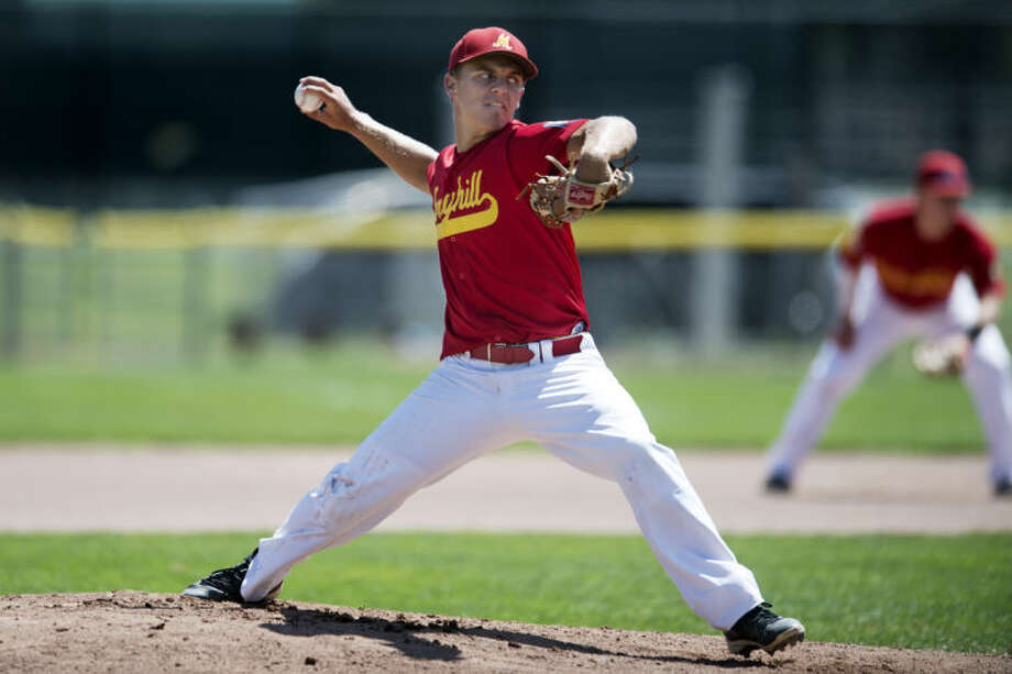 NEIL BLAKE | nblake@mdn.netBerryhill's Jake Somerville pitches against Newaygo during a district tournament game at Northwood University on Thursday. Photo: Neil Blake/Midland  Daily News
