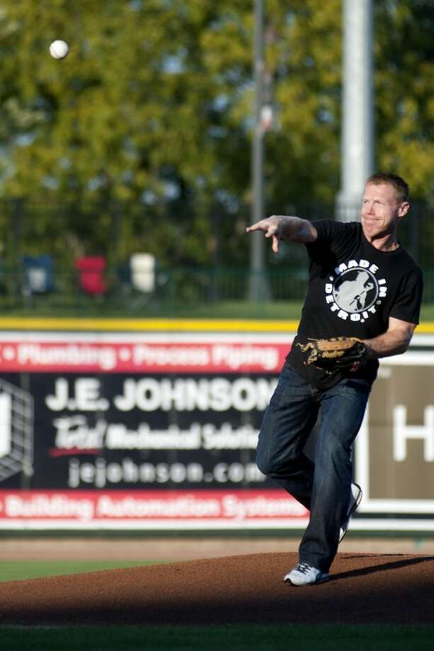 BRITTNEY LOHMILLER | blohmiller@mdn.netFormer Detroit Red Wings' player Kris Draper throws the opening pitch at the Great Lakes Loons game Wednesday evening at Dow Diamond. Photo: Brittney Lohmiller