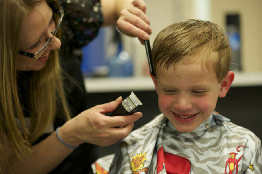 Photo providedA youngster receives a free haircut at West Midland Family Center.